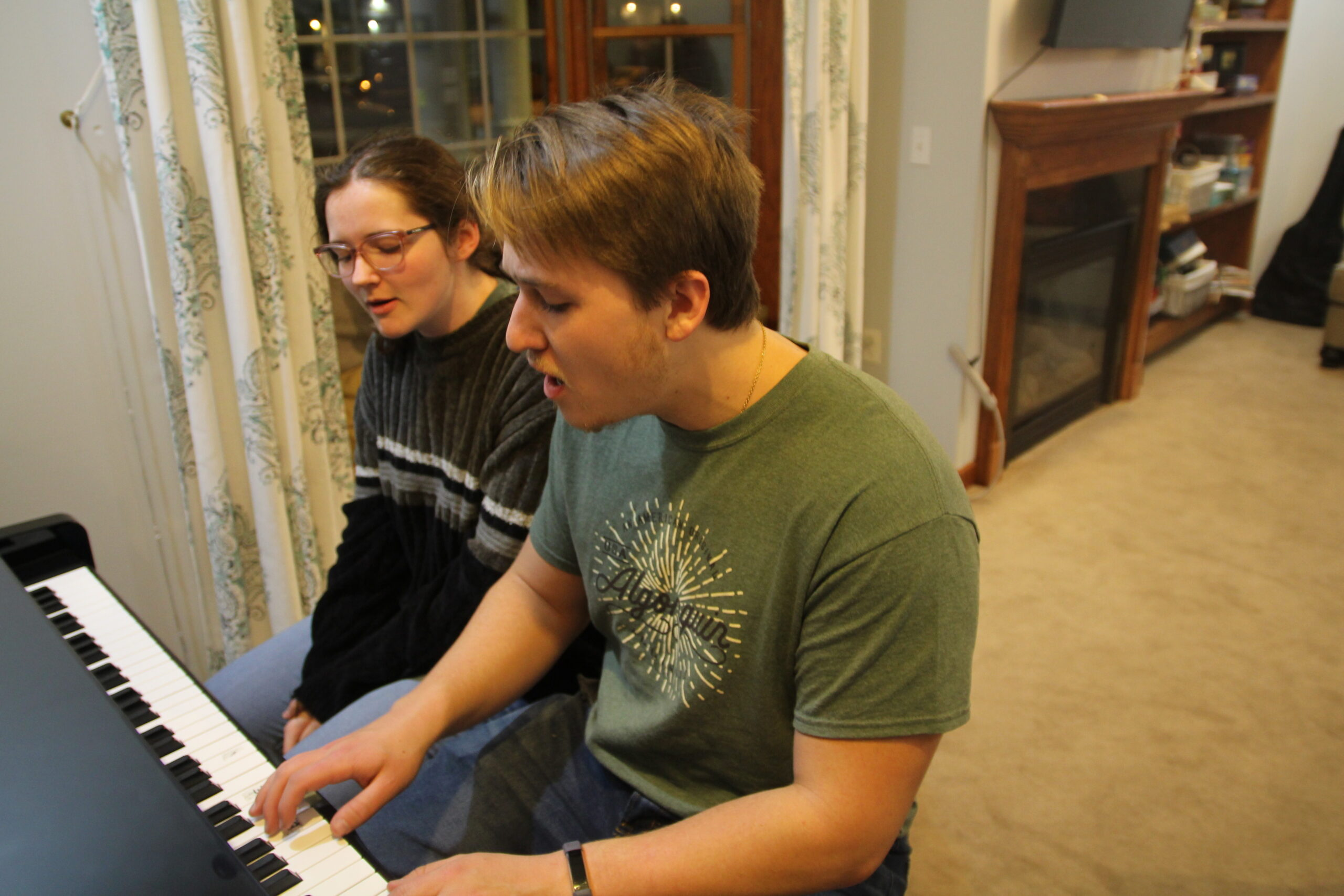 """The """"OkCupid"""" couple sings a worship song as a part of their nightly routine in Champaign, IL on Tuesday, Dec. 3, 2019."""