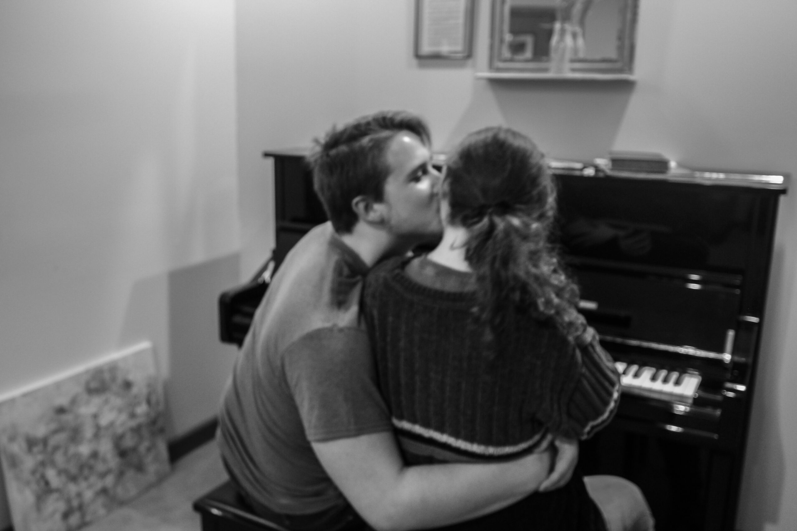 Mike Skibski takes a break from playing the piano to hug and kiss his girlfriend of over 8 months, Mady Ford, in Champaign, IL on Tuesday, Dec. 3, 2019.